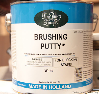 use brushing putty to cover wood grain when painting cabinets