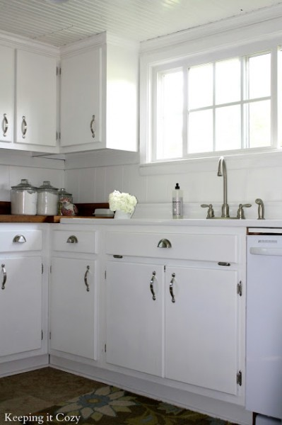 white kitchen cabinets with stainless steel pulls. best kitchen remodel ideas -- white painted cabinets with reclaimed wood countertops, Keeping It Cozy on Remodelaholic