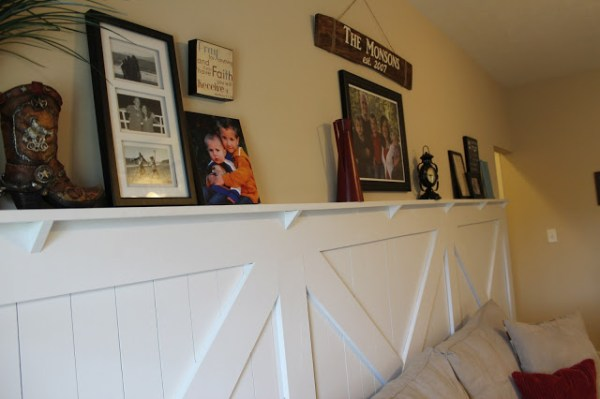 decorated barn door wainscoting ledge faux mantel