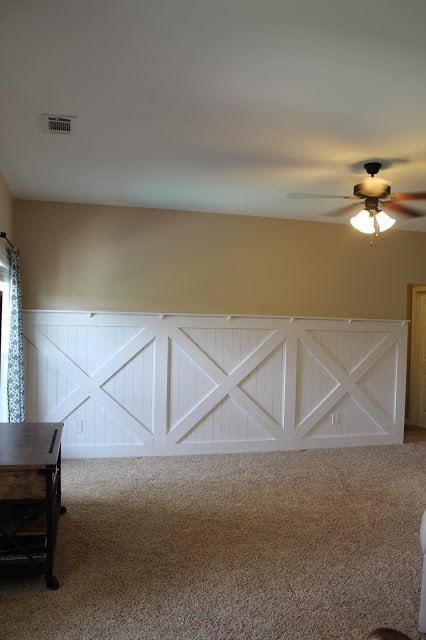 finished barn door wainscoting wall treatment