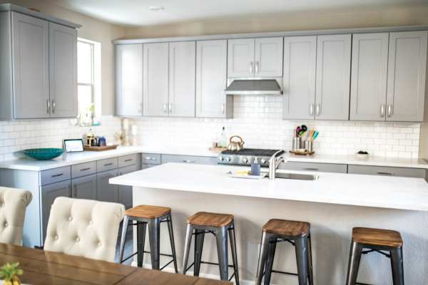 Gray And White Kitchen Cabinets With Subway Tile Backsplash, Never Skip Brunch