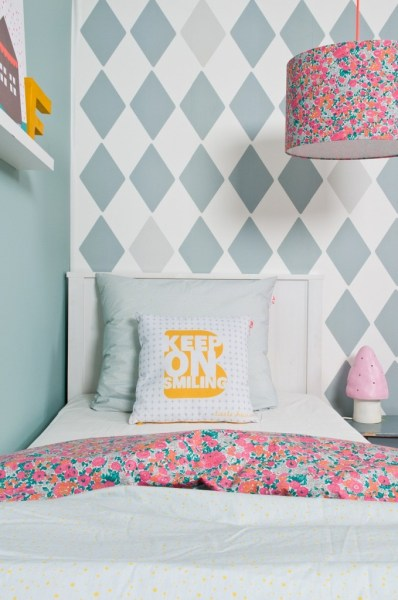 pattern mixing girls room with diamond argyle wall