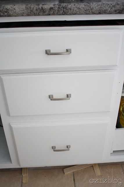thrifted kitchen cabinets in a white kitchen remodel