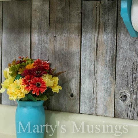 unique wood kitchen backsplash from reclaimed fence posts