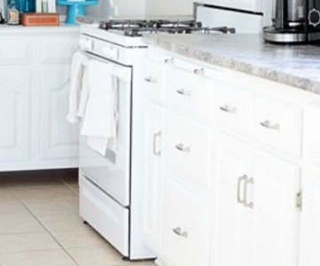 White Kitchen Remodel Using Thrifted Cabinets
