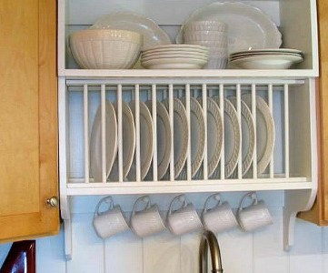 feature mix builder grade and custom cabinets with a custom plate rack shelf and cabinet