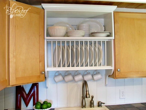 mix builder grade and custom cabinets with a custom plate rack shelf and cabinet
