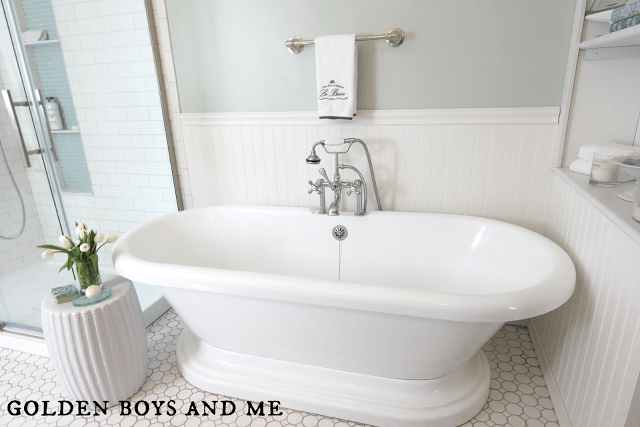 bathtub in elegant master bath remodel, featured on Remodelaholic.com