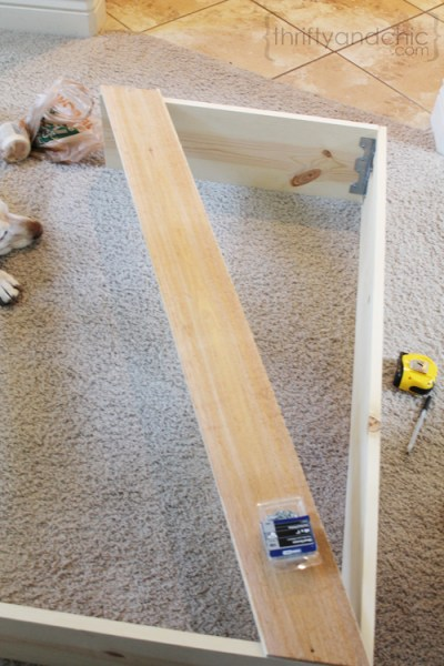 diy X sofa table, featured on Remodelaholic.com