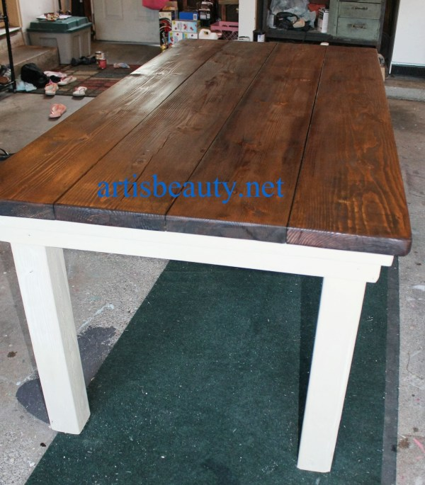 diy farmhouse table with provincial stained top and CeCe Caldwell chalk painted legs, featured on Remodelaholic.com