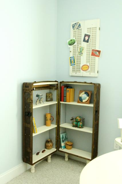 finished bookshelf from an antique trunk and travel postcard shutter display, featured on Remodelaholic.com