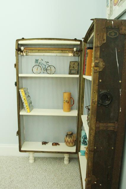 finished bookshelf from an antique trunk or suitcase, featured on Remodelaholic.com
