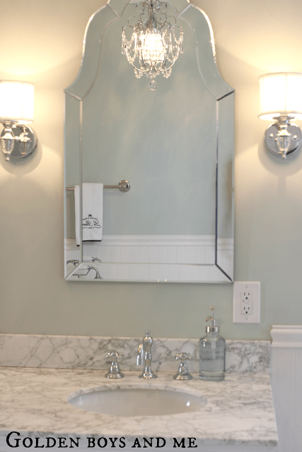 gorgeous shaped mirror in an elegant master bath, featured on Remodelaholic.com