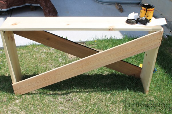 simple X sofa table DIY building plans, featured on Remodelaholic.com