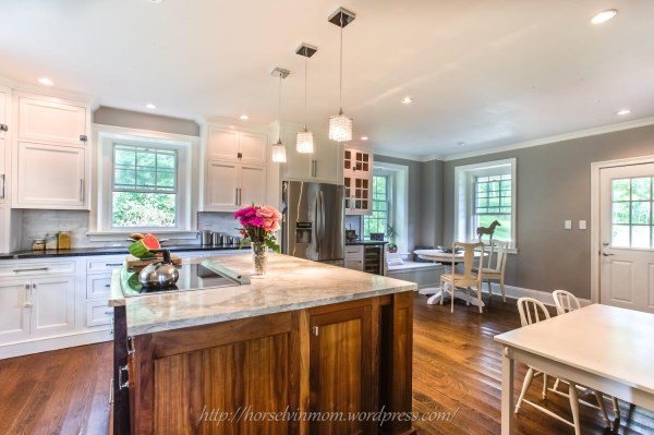 white country kitchen remodel with pendant lights, featured at Remodelaholic.com