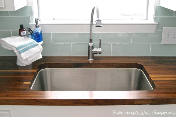 finished undermount sink with butcherblock countertops - small kitchen remodel, Fisherman's Wife Furniture featured on Remodelaholic.com