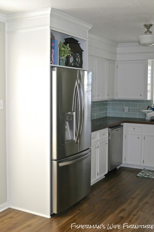 fridge enclosure - vinyl plank flooring - white cabinets - kitchen makeover, Fisherman's Wife Furniture featured on Remodelaholic.com
