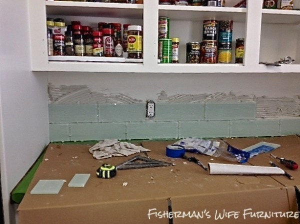 installing glass subway tile backsplash, Fisherman's Wife Furniture featured on Remodelaholic.com