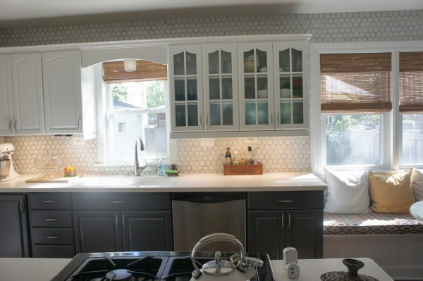 kitchen makeover with hexagon tile backsplash and painted gray and white cabinets, LoveLee Homemaker featured on Remodelaholic