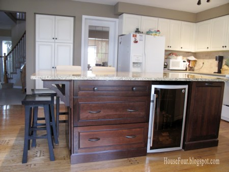 new kitchen island with built-in fridge and bookshelf, House for Four via Remodelaholic.com