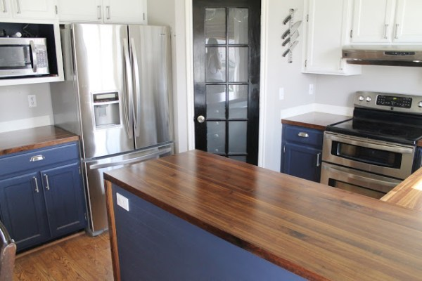 white and wood kitchen with navy cabinets, Chris Loves Julia