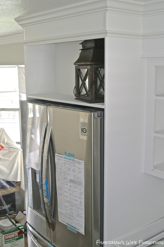 white painted fridge enclosure and fur down, Fisherman's Wife Furniture featured on Remodelaholic.com