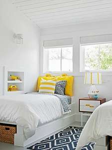 yellow and navy shared bedroom via Remodelaholic.com