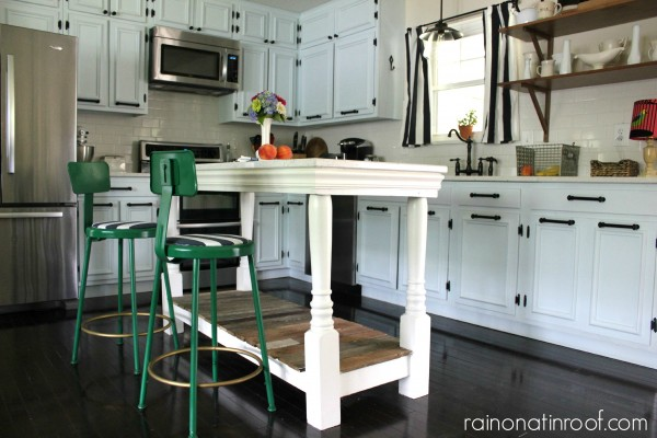 1960's kitchen renovation with painted cabinets and a custom kitchen island, Rain On A Tin Roof featured on Remodelaholic