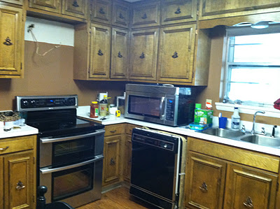 1960's ranch kitchen pre-renovation, Rain On A Tin Roof featured on Remodelaholic