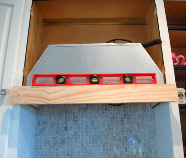 front face on bottom support for diy custom range hood, The Rozy Home featured on Remodelaholic