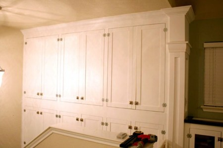 wall of built-in cabinets for family room storage, Remodelaholic