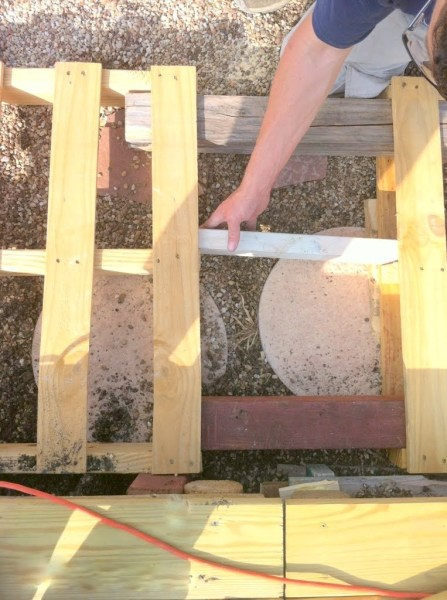 add support boards in spaces of wooden pallet deck, The Second Wind of Texas featured on Remodelaholic