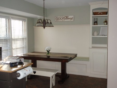 banquette bench with built-in shelf, featured on Remodelaholic
