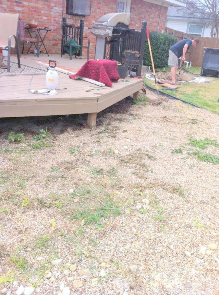 leveling the ground before building the wooden pallet deck, The Second Wind of Texas featured on Remodelaholic