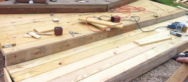 second tier of wooden pallet deck, The Second Wind of Texas featured on Remodelaholic