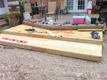 tutorial for building a tiered wooden pallet deck, The Second Wind of Texas featured on Remodelaholic