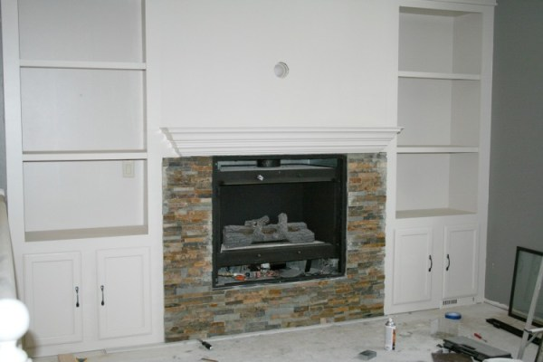 fireplace makeover with stone tiles and built-in shelves, construction2style on Remodelaholic