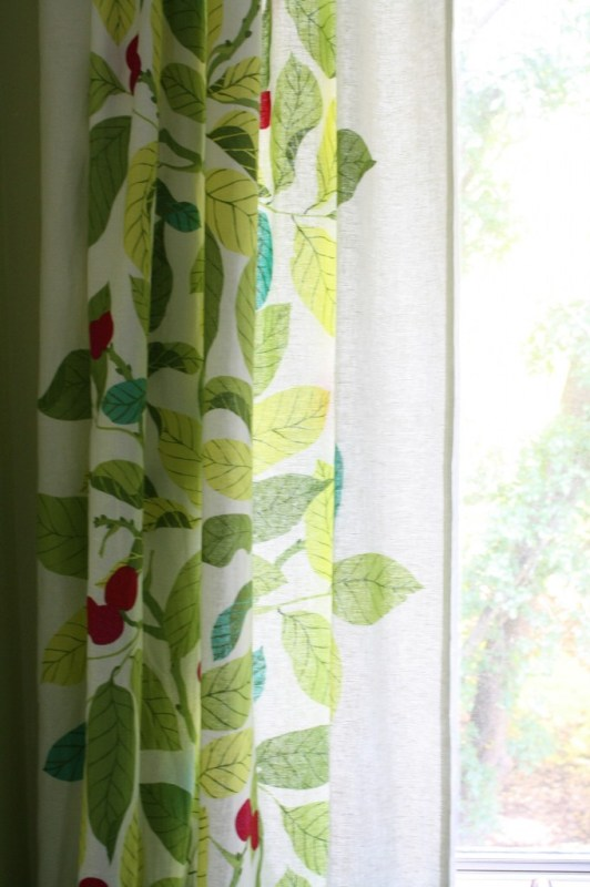 floral ikea curtains for the laundry room, featured on Remodelaholic