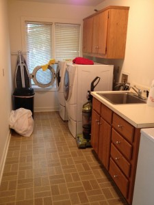 laundry room before, featured on Remodelaholic