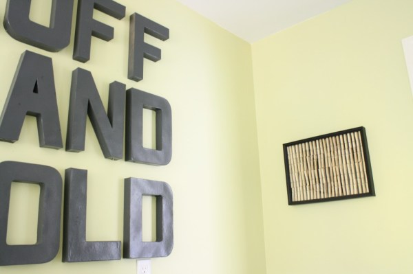 low cost laundry room wall decor, featured on Remodelaholic