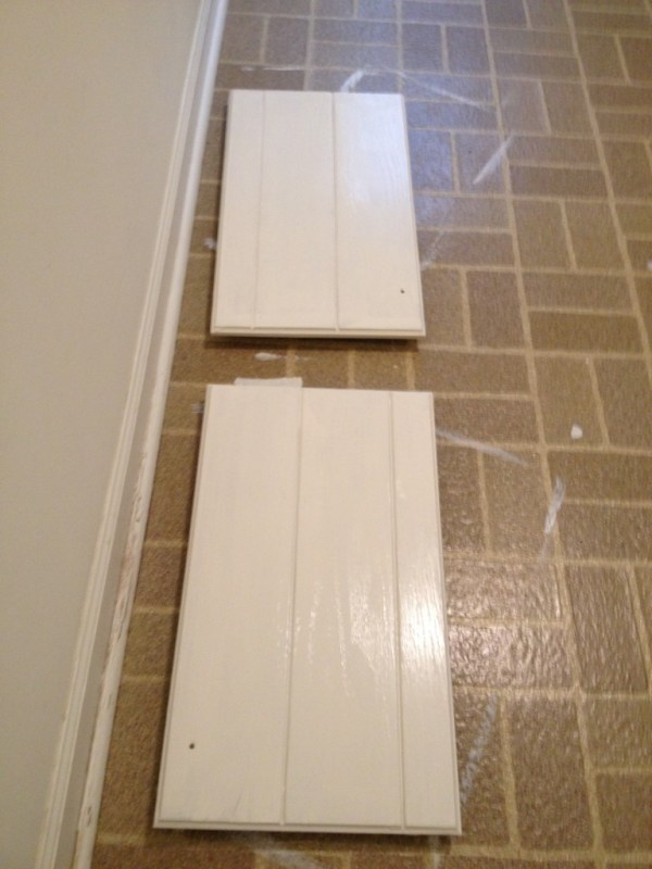 painting laundry room cabinet doors, featured on Remodelaholic