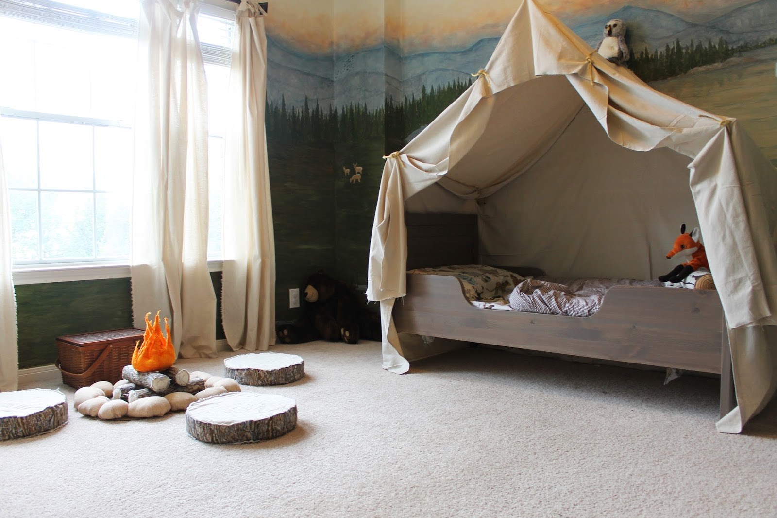 woodland themed kids room with camping tent bed and play campfire, The  Ragged Wren on