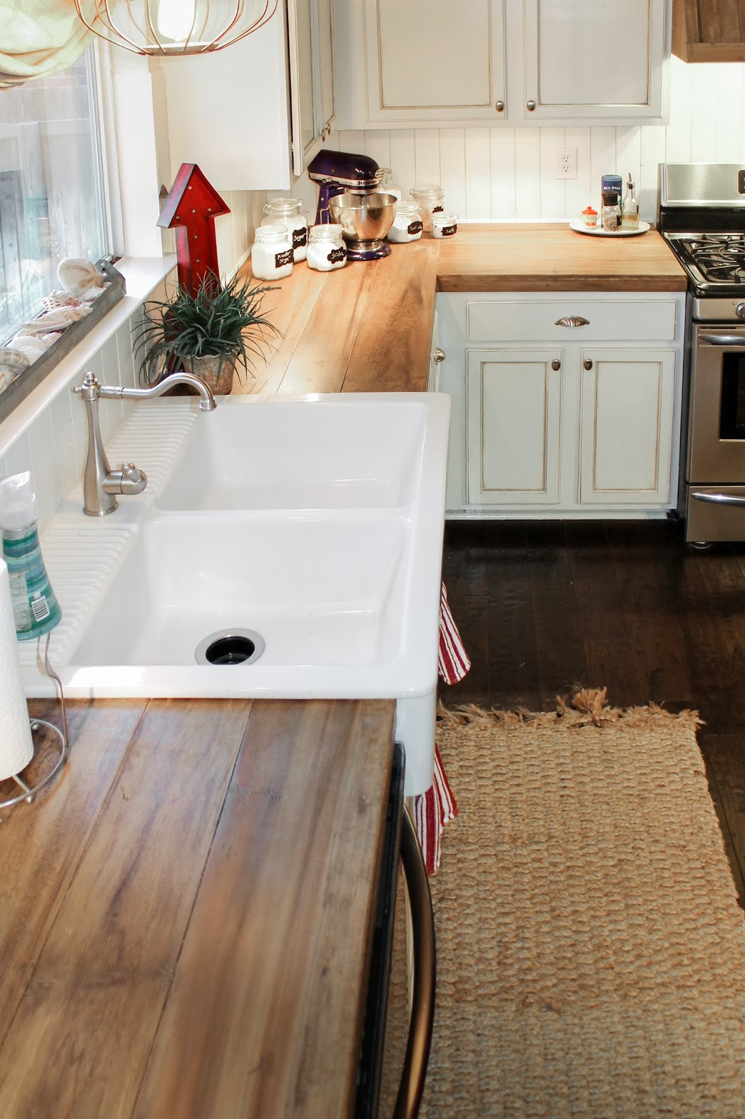 faux reclaimed wood kitchen counters | The Ragged Wren on Remodelaholic.com & Remodelaholic | How to Create Faux Reclaimed Wood Countertops