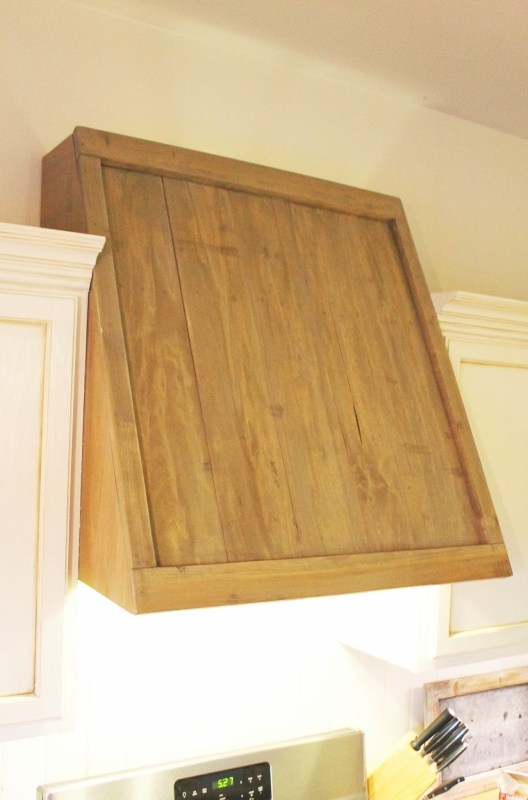faux reclaimed wood range hood | The Ragged Wren on Remodelaholic.com
