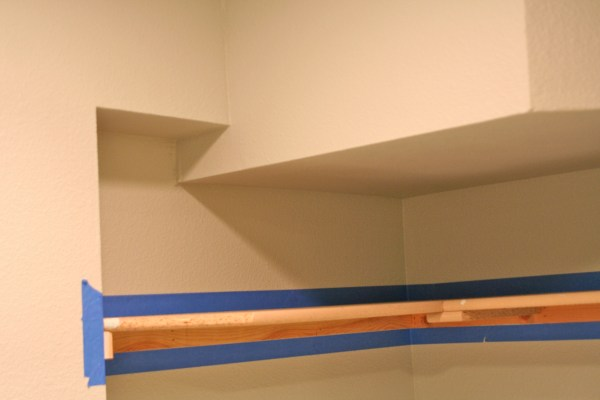 painting laundry room shelves, Love Melinda on Remodelaholic