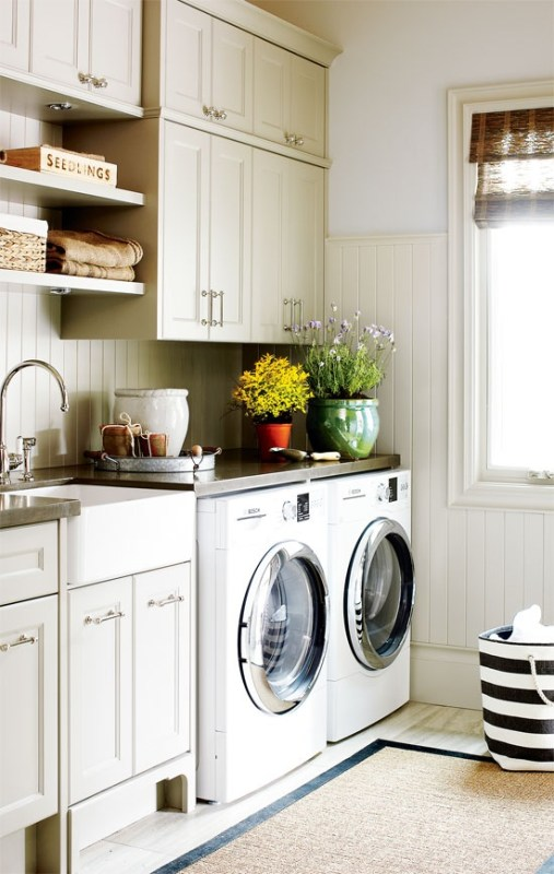 Beautiful millwork and cabinetry laundry room featured on Remodelaholic.com