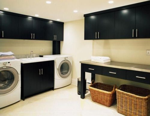 Black cabinets, but convert table to rolling island and laundry rooms featured on Remodelaholic.com