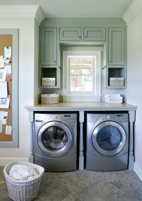 Laundry in corner of a small laundry room featured on Remodelaholic.com