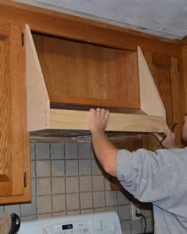 How to create a Custom Storage Range Hood via @Remodelaholic #kitchenstorage #whitekitchen #DIYkitchen #rangehood on Remodelaholic.com