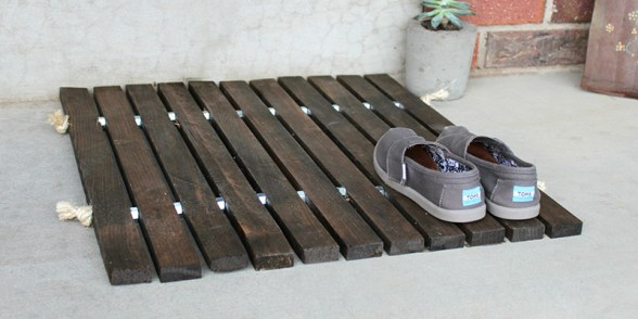 Wooden Doormat diy curb appeal ideas from Remodelaholic